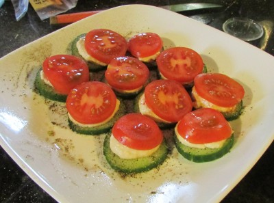 Cucumber, hummus and tomato slice snack for me!